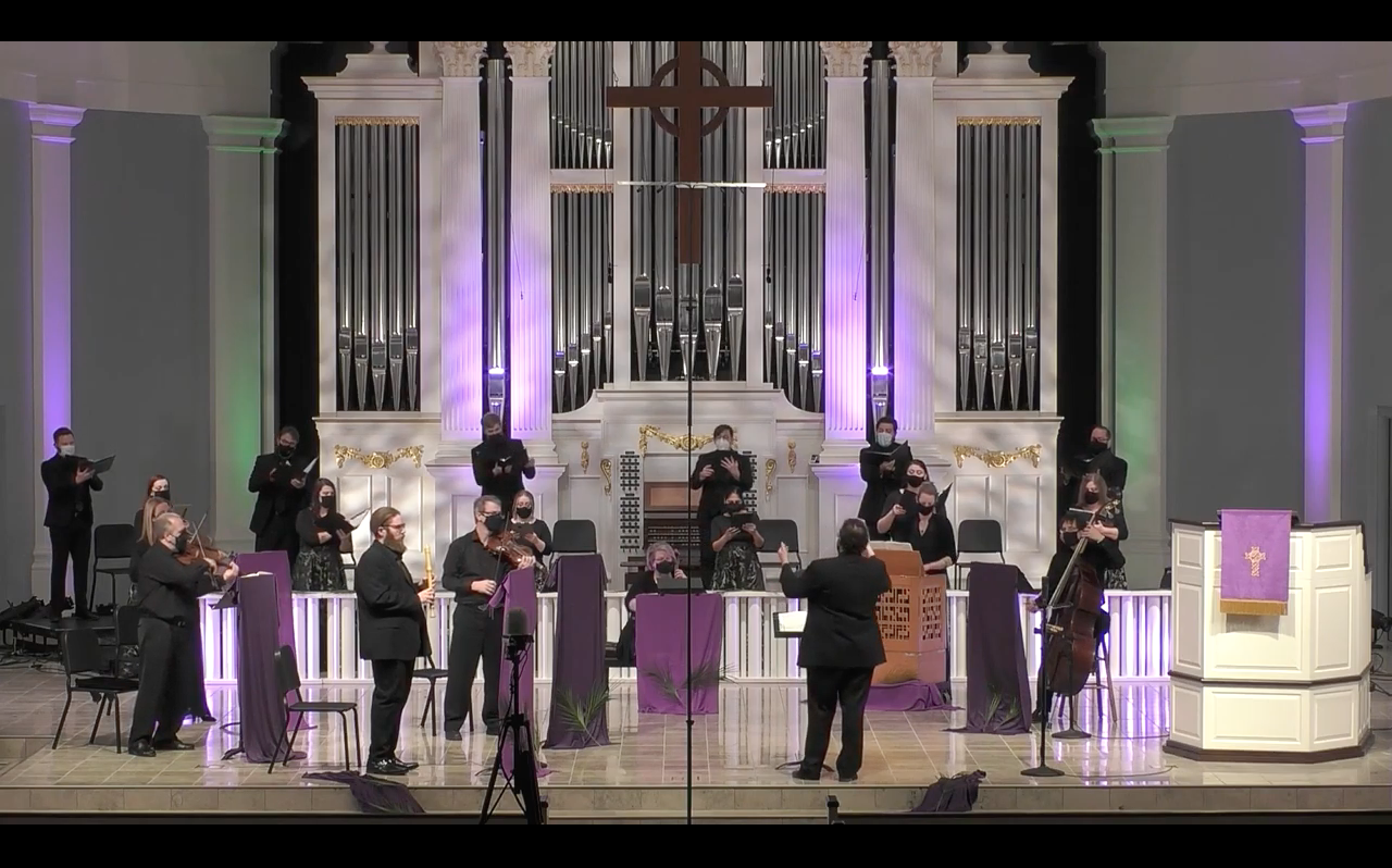Choir and instrumentalists perform in church.