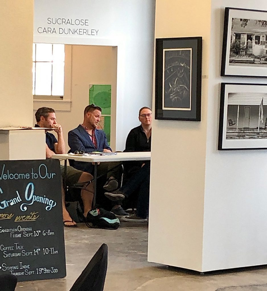 """Lawyers and a sign language interpreter speak with a client (not pictured) during the """"Ask the Experts"""" program at the Kansas City Artists Coalition in September 2019. (photo by Debra Smith)"""