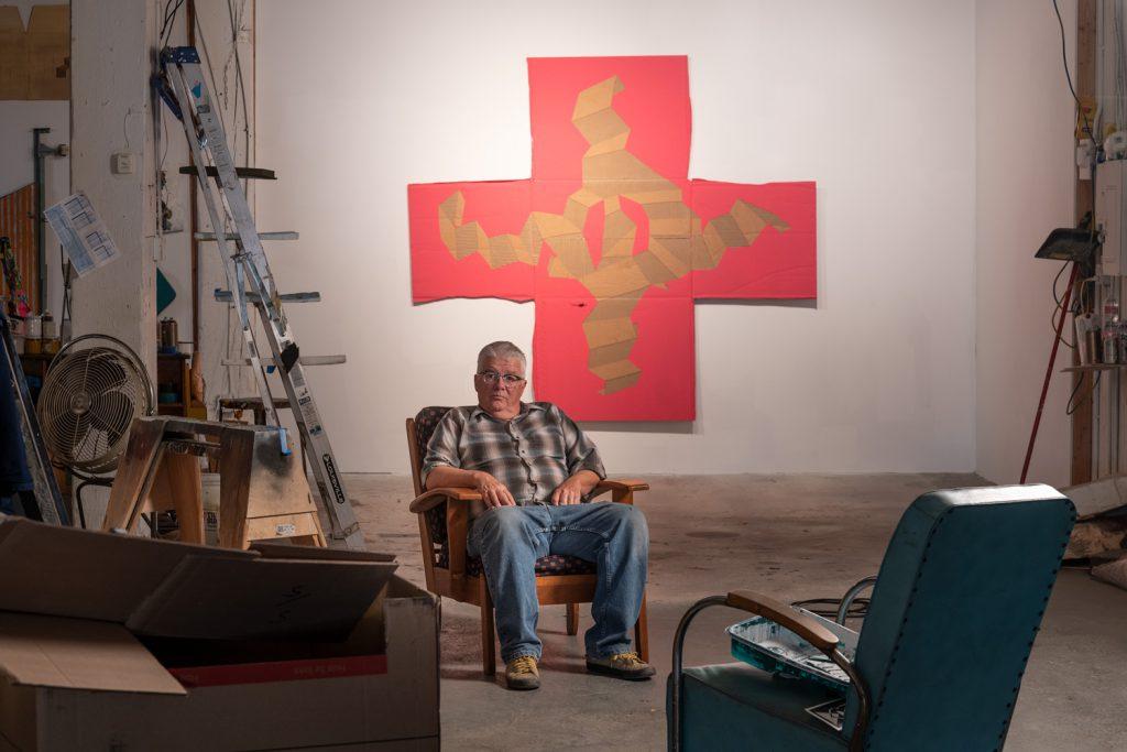"In June 2019 Schempf photographed Kansas City artist Garry Noland with his ""Construction Cross."" (photo by E.G. Schempf)"
