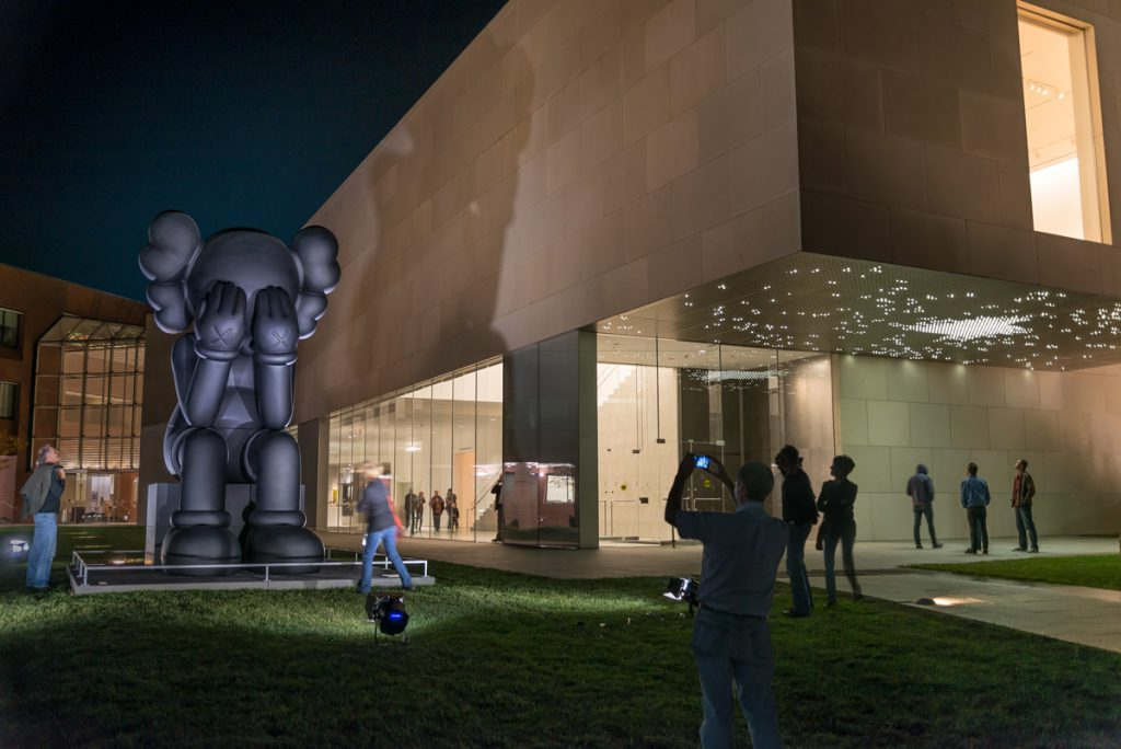 Among the many photographs Schempf shot for the Nerman Museum of Contemporary Art, this image of the fall 2013 opening night of the museum's KAWS exhibit is one of his favorites. (photo by E.G. Schempf)