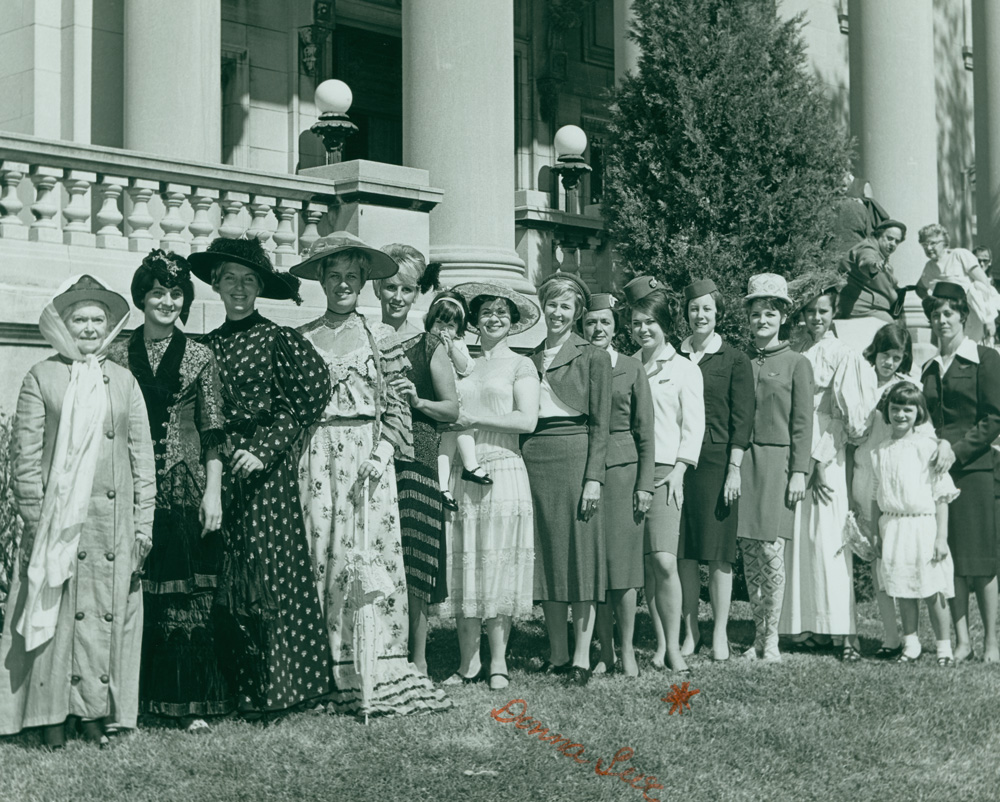 Women's Division volunteers wearing costumes from the museum's collection posed on the museum's front lawn, ca. 1968.