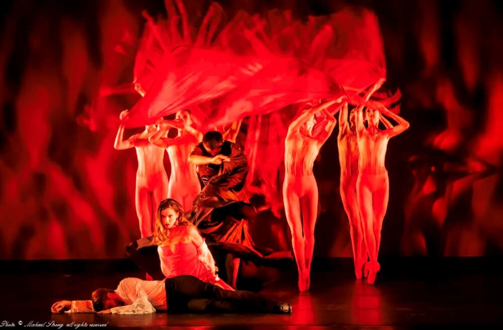 Ballet dancers with a red background.