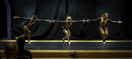 Three dancers left to right Black man, white woman, Black women